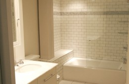 LUX Subway-tiled Guest Baths in Chic Industrial Riverfront Loft